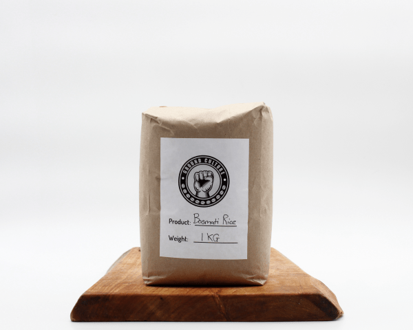 White basmati Rice in brown biodegradable packaging on a wooden board with a white background