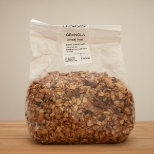 homemade granola sitting on a wooden table