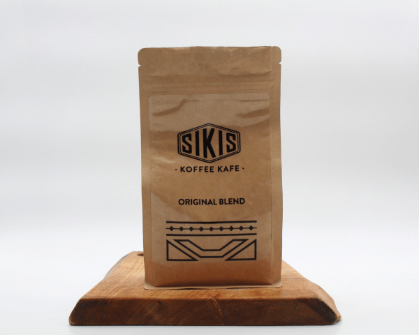 Sikis African Coffee blend on a wooden board with a white background