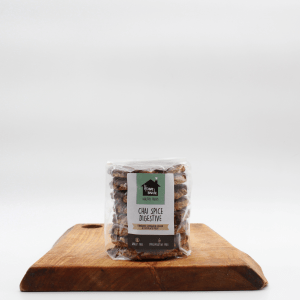 Chai Spice Digestive Biscuit on a wooden board with a white background