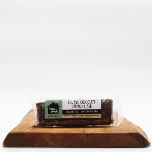 Double crunchy bar sitting on a wooden board with a white background.